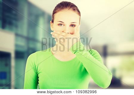 Attractive woman covering her mouth
