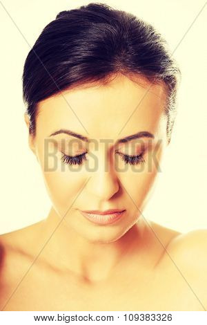 Sensual portrait of a woman with closed eyes.