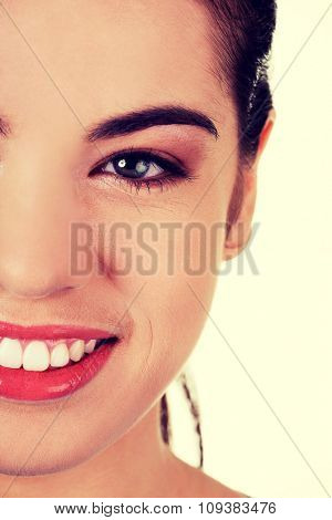 Half portrait of a smiling woman.