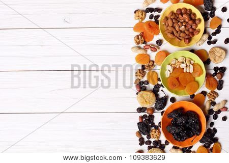 Dried Fruits And Nuts On White Wooden Background