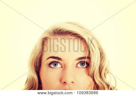 Closeup of beautiful woman eyes looking up.