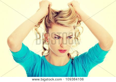 Portrait of angry woman pulling her hair.