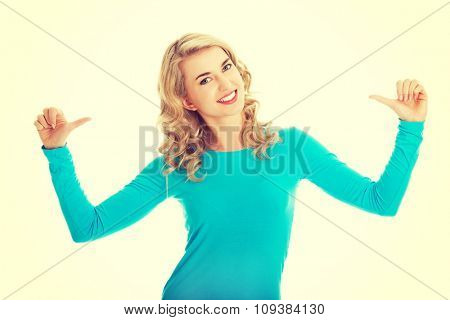 Portrait of woman pointing on herself.