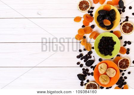 Dried Fruits On White Wooden Background