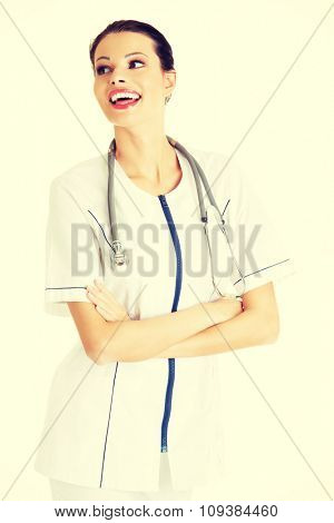 Happy female doctor with folded arms.