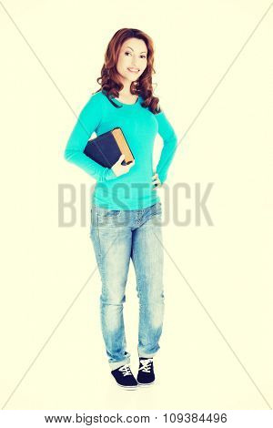 Student woman holding a book.