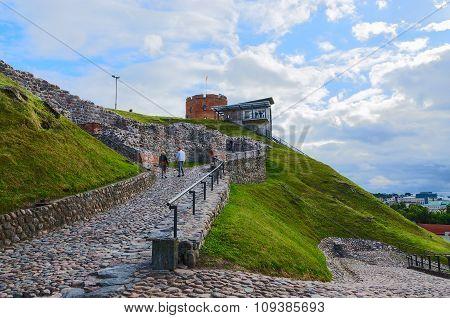Tourists Climb The Mountain Gediminas The Rocky Road To The Tower Of Gediminas