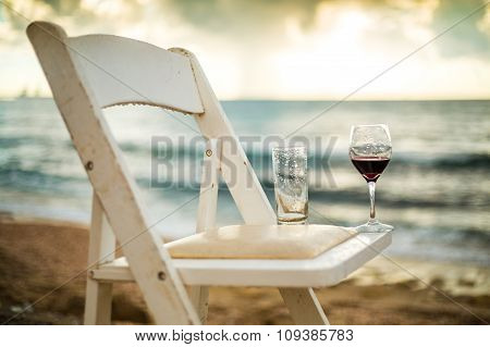 White Chair With Wineglass On A Beach