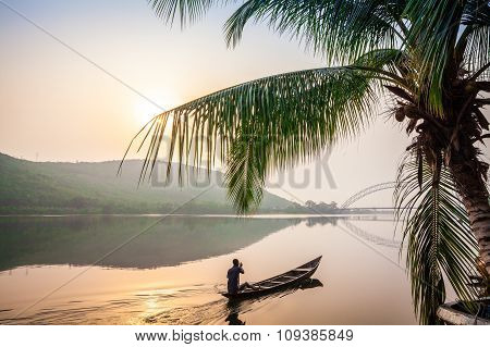 Paddling In Traditional Wooden Canoe