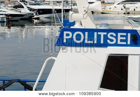 Police Boat On A Background Of Yachts