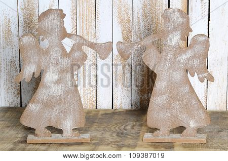 Two Figure Of An Angel With A Trumpet Made Wood.