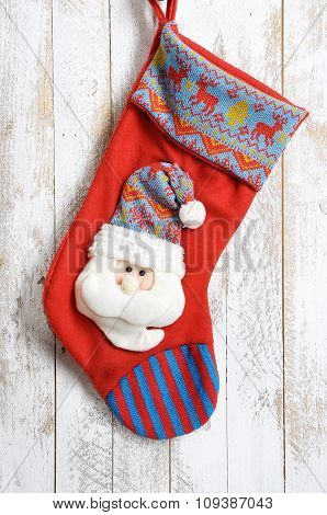 Decorative Christmas Sock With Santa. Isolated On Wooden Background
