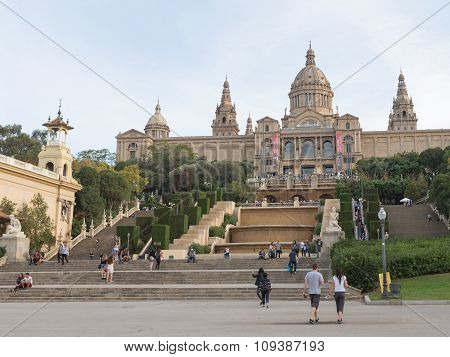 Tourists Walk From The National Museum Of Art Of Catalonia