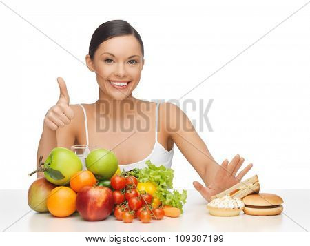 picture of woman with fruits showing thumbs up