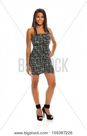 Portrait of beautiful African American woman standing isolated over white background