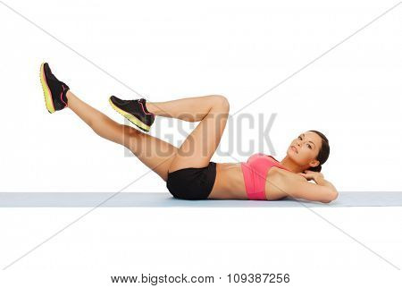 fitness, sport, training, gym and lifestyle concept - beautiful sporty woman doing exercise on the floor