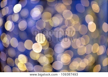 christmas, holidays and background concept - blurred blue and golden lights bokeh