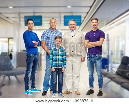 travel, tourism, gender, generation and people concept - group of smiling men and boy over airport waiting room background