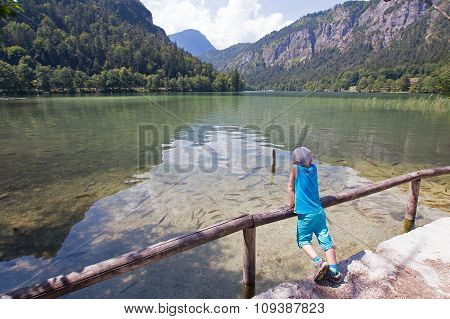 Boy Looking On A Lake