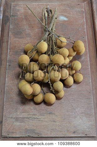 Longan Thai fruit on wood board