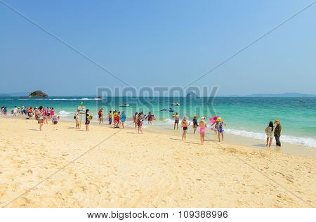 People Relaxing, Shooting Photo, Having Fun On The Beach.