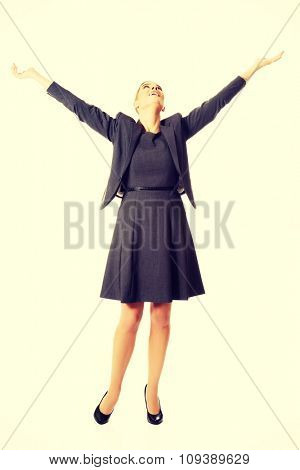 Beautiful woman raising arms high.