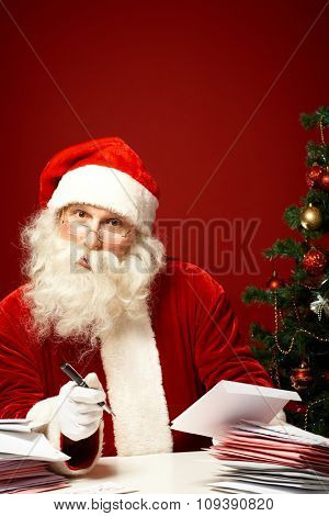 Santa Claus answering letters on Christmas eve