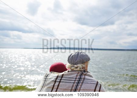 Back view of affectionate seniors view of seaside