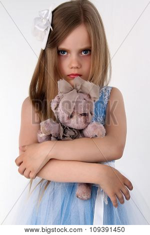 portrait of the beautiful little girl with long hair