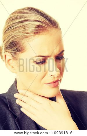 Woman having huge throat pain