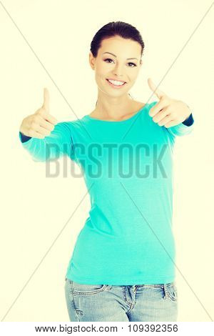 Happy woman gesturing thumbs up.