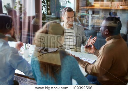 Several business partners consulting in office