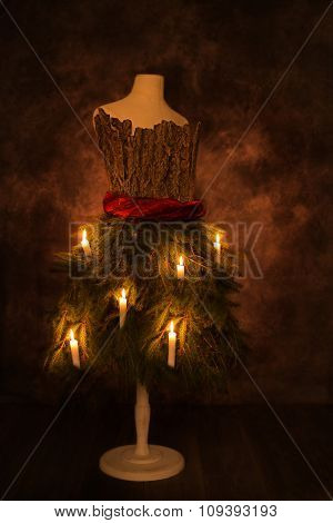 Festive Christmas candles on decorated mannequin