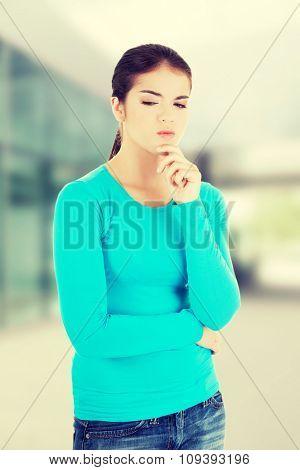 Beautiful teenage girl is thinking