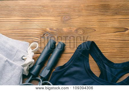 Women's Sports Clothing On A Wooden Background