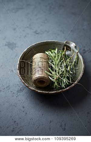 Fresh rosemary and a kitchen twine