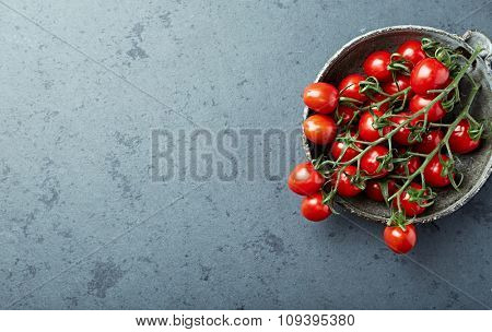 Organic cherry tomatoes in a ceramic bowl