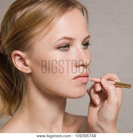 Beautiful Woman Having Lipstick Applied By Make-up Artist