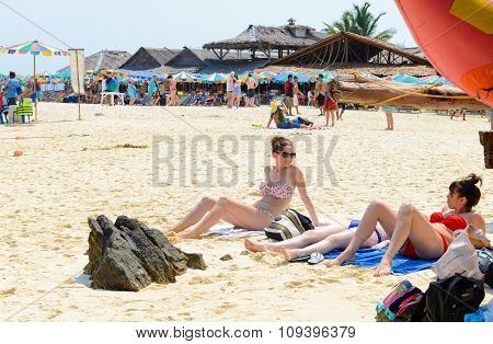 Beautiful Woman Sunbathe, Relaxing On The Beach