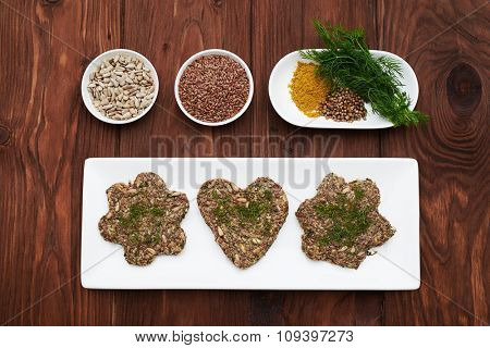 diet detox raw food selection in white bowls over brown wooden background