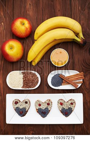 tasty raw cookies and healthy ingredients on wooden background