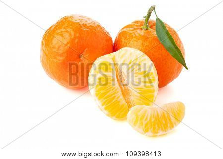 Ripe tangerines with green leaf. Isolated on white