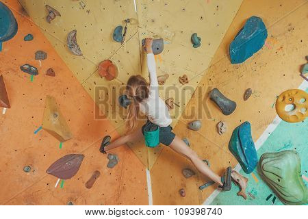 Girl Climbing In Gym