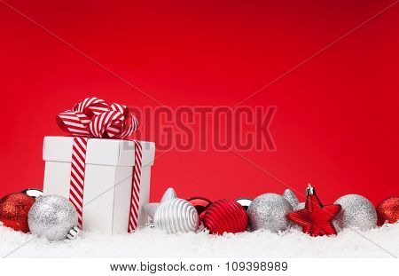 Christmas background with baubles, gift box and copy space