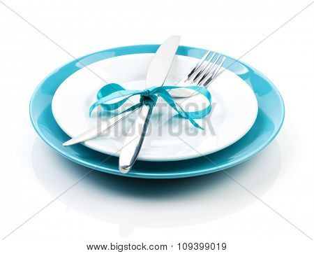 Fork with knife over blank plates. Isolated on white background
