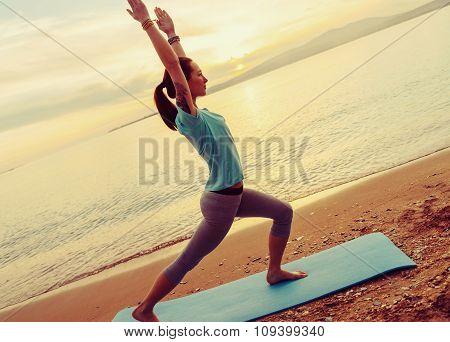Girl Practicing Yoga On Coast