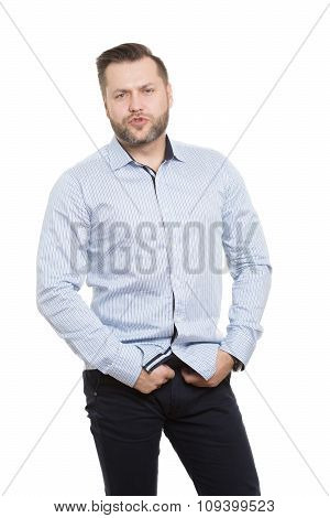 causing sexual pose. adult male with a beard. isolated white background. hands on the belt. genital