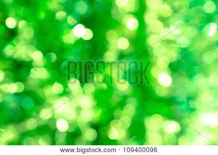 Abstract Blured Background Of Green Shiny Christmas Tree Decorations