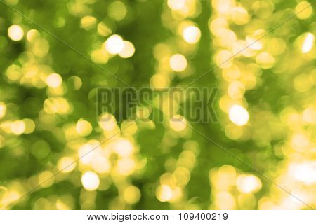 Abstract Blured Background Of Yellow Shiny Christmas Tree Decorations