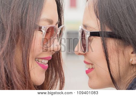 best friends trendy girls look at each other